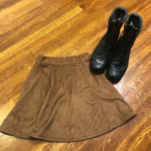 Trendy little soft suede like skirt by DIVIDED. XS